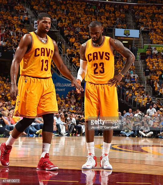 LeBron James and Tristan Thompson of the Cleveland Cavaliers shake hands after the play against the Atlanta Hawks at the Quicken Loans Arena During...