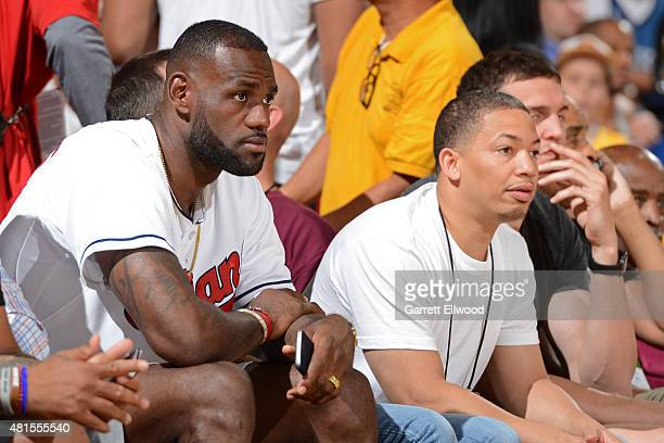 LeBron James and Tyronn Lue of the Cleveland Cavaliers attend the game to watch their team play against the Minnesota Timberwolves in the Las Vegas...