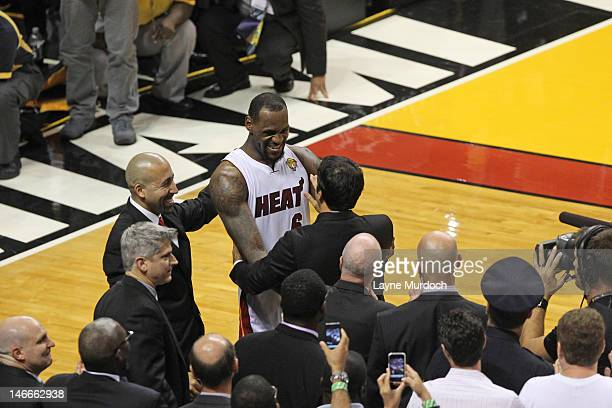 LeBron James celebrates with Head Coach Erik Spoelstra as their team wins the NBA Championship by defeating the Oklahoma City Thunder in Game Five of...