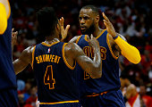 LeBron James celebrates with Iman Shumpert of the Cleveland Cavaliers after scoring in the second quarter against the Atlanta Hawks during Game Two...
