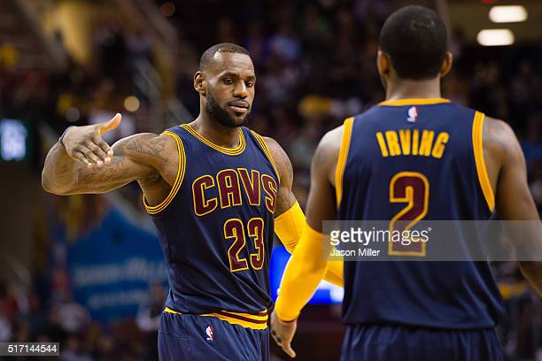 LeBron James celebrates with Kyrie Irving of the Cleveland Cavaliers after scoring during the second half against the Milwaukee Bucks at Quicken...