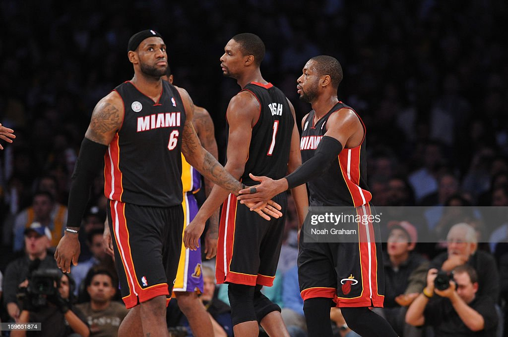 LeBron James #6, Chris Bosh #1, and Dwyane Wade #3 of the Miami Heat come together against the Los Angeles Lakers at Staples Center on January 15, 2013 in Los Angeles, California.