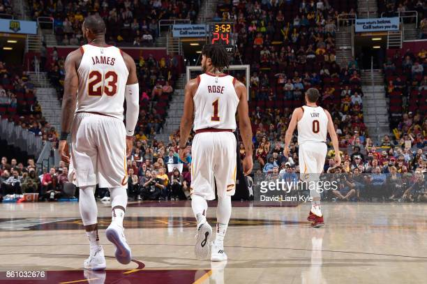 LeBron James Derrick Rose and Kevin Love of the Cleveland Cavaliers are seen on the court during the pre season game against the Chicago Bulls on...