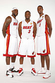 LeBron James Dwyane Wade and Chris Bosh of the Miami Heat pose for a portrait during the 2012 Miami Heat Media Day on September 28 2012 at American...