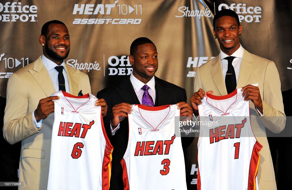 LeBron James Dwyane Wade and Chris Bosh of the Miami Heat show off their new game jerseys before a press conference after a welcome party at American...