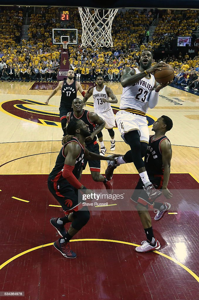 LeBron James flies between DeMarre Carroll and Kyle Lowry as the Toronto Raptors lose the Cleveland Cavaliers in game 5 of the NBA Conference Finals at Quicken Loans Arena in Cleveland. May 25, 2016.
