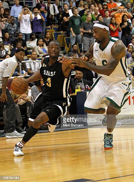 LeBron James guards Dwyane Wade during the South Florida All Star Classic at Florida International University on October 8 2011 in Miami Florida