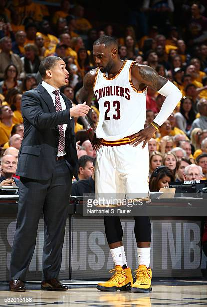 LeBron James is coached by Tyronn Lue of the Cleveland Cavaliers during the game against the Toronto Raptors in Game One of the Eastern Conference...