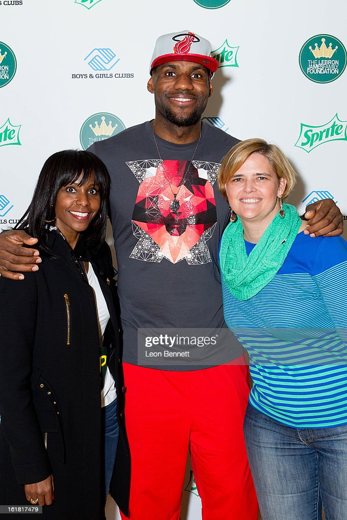 LeBron James (C) joined Kim Paige, Vice President, Sprite, Coca-Cola North America and Ellen Lucey, Director of Sports Marketing NBA, Coca-Cola North America, during an appearance to unveil a refurbished gymnasium at the Boys & Girls Club of Houston on February 16, 2013 in Houston, Texas.