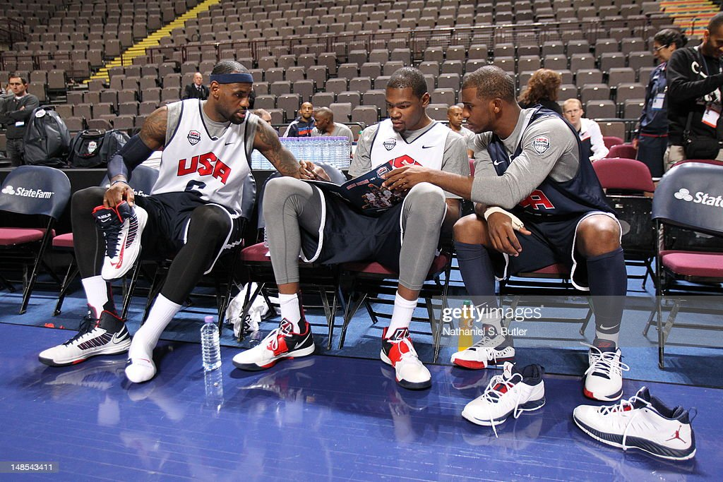 <a gi-track='captionPersonalityLinkClicked' href=/galleries/search?phrase=LeBron+James&family=editorial&specificpeople=201474 ng-click='$event.stopPropagation()'>LeBron James</a> #6, <a gi-track='captionPersonalityLinkClicked' href=/galleries/search?phrase=Kevin+Durant&family=editorial&specificpeople=3847329 ng-click='$event.stopPropagation()'>Kevin Durant</a> #5 and <a gi-track='captionPersonalityLinkClicked' href=/galleries/search?phrase=Chris+Paul&family=editorial&specificpeople=212762 ng-click='$event.stopPropagation()'>Chris Paul</a> of the 2012 US Men's Senior National Team sit on the bench during a 2012 US Men's Senior National Team Practice at the Manchester Arena on July 18, 2012 in Manchester, UK.