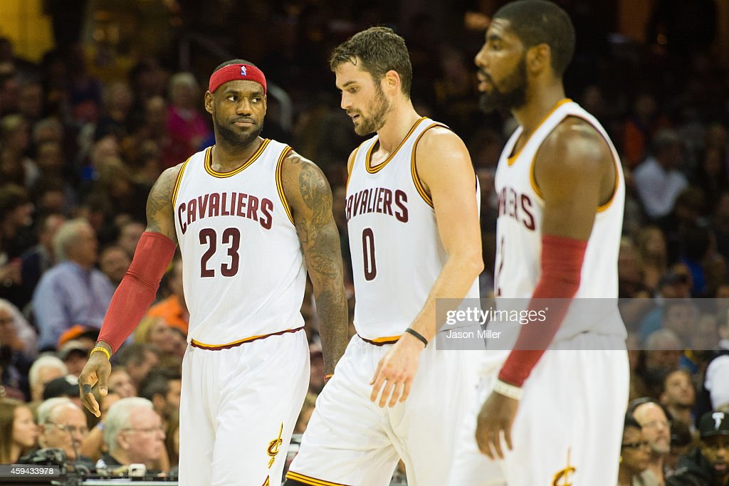 LeBron James #23 Kevin Love #0 and Kyrie Irving #2 of the Cleveland Cavaliers walk off the court during a time out during the first half against the Toronto Raptors at Quicken Loans Arena on November 22, 2014 in Cleveland, Ohio.