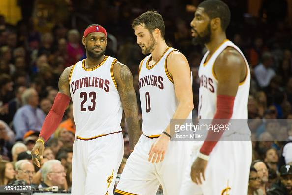 LeBron James Kevin Love and Kyrie Irving of the Cleveland Cavaliers walk off the court during a time out during the first half against the Toronto...