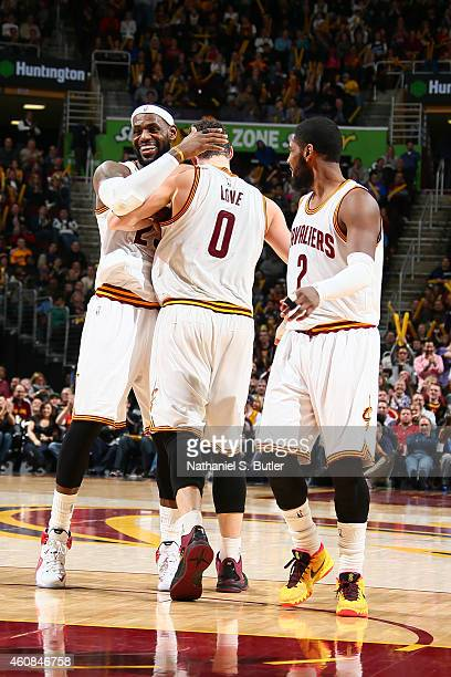 LeBron James Kevin Love and Kyrie Irving of the Cleveland Cavaliers celebrate during a game against the Minnesota Timberwolves during the game on...