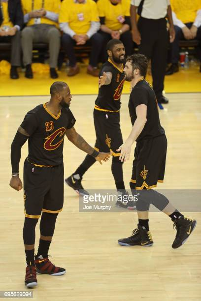 LeBron James Kevin Love and Kyrie Irving of the Cleveland Cavaliers high five in Game Five of the 2017 NBA Finals against the Golden State Warriors...