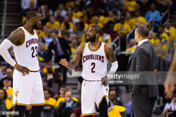 LeBron James Kyrie Irving and head coach Tyronn Lue of the Cleveland Cavaliers talk during the second half of Game One of the NBA Eastern Conference...