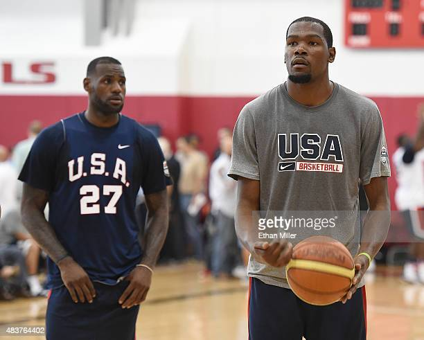 LeBron James looks on as Kevin Durant of the 2015 USA Basketball Men's National Team shoots a free throw during a practice session at the Mendenhall...