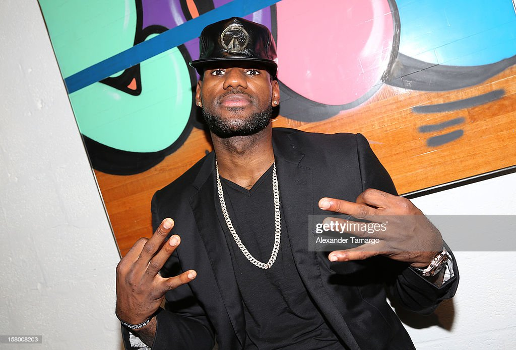 <a gi-track='captionPersonalityLinkClicked' href=/galleries/search?phrase=LeBron+James&family=editorial&specificpeople=201474 ng-click='$event.stopPropagation()'>LeBron James</a> makes an appearance as Premier Beverage Hosts Art Of Basketball: Heat Wave With Dwyane Wade & Chris Bosh on December 7, 2012 in Miami, Florida.