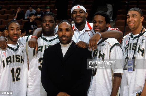 LeBron James of Team West poses for a photo with St VincentSt Mary's teammates during the EA Sports Roundball Classic game against Team East at...