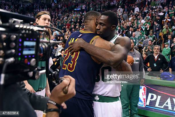 LeBron James of the Cleveland Cavaliers and Brandon Bass of the Boston Celtics hug after Game Four of the Eastern Conference Quarterfinals during the...