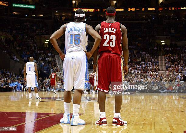 LeBron James of the Cleveland Cavaliers and Carmelo Anthony of the Denver Nuggets wait for play to start back up November 5 2003 at Gund Arena in...