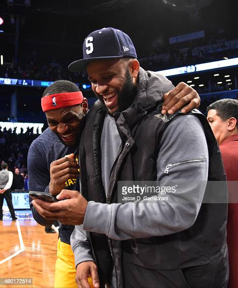 LeBron James of the Cleveland Cavaliers and CC Sabathia of the New York Yankees laughs after the game against the Brooklyn Nets at the Barclays...