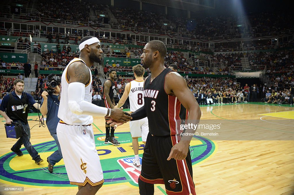 LeBron James of the Cleveland Cavaliers and Dwyane Wade of the Miami Heat shake hands after a game at the HSBC Arena as a part of NBA Global Games on...