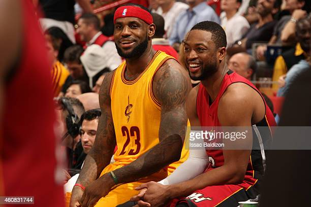 LeBron James of the Cleveland Cavaliers and Dwyane Wade of the Miami Heat converse during a game at the American Airlines Arena on December 25 2014...