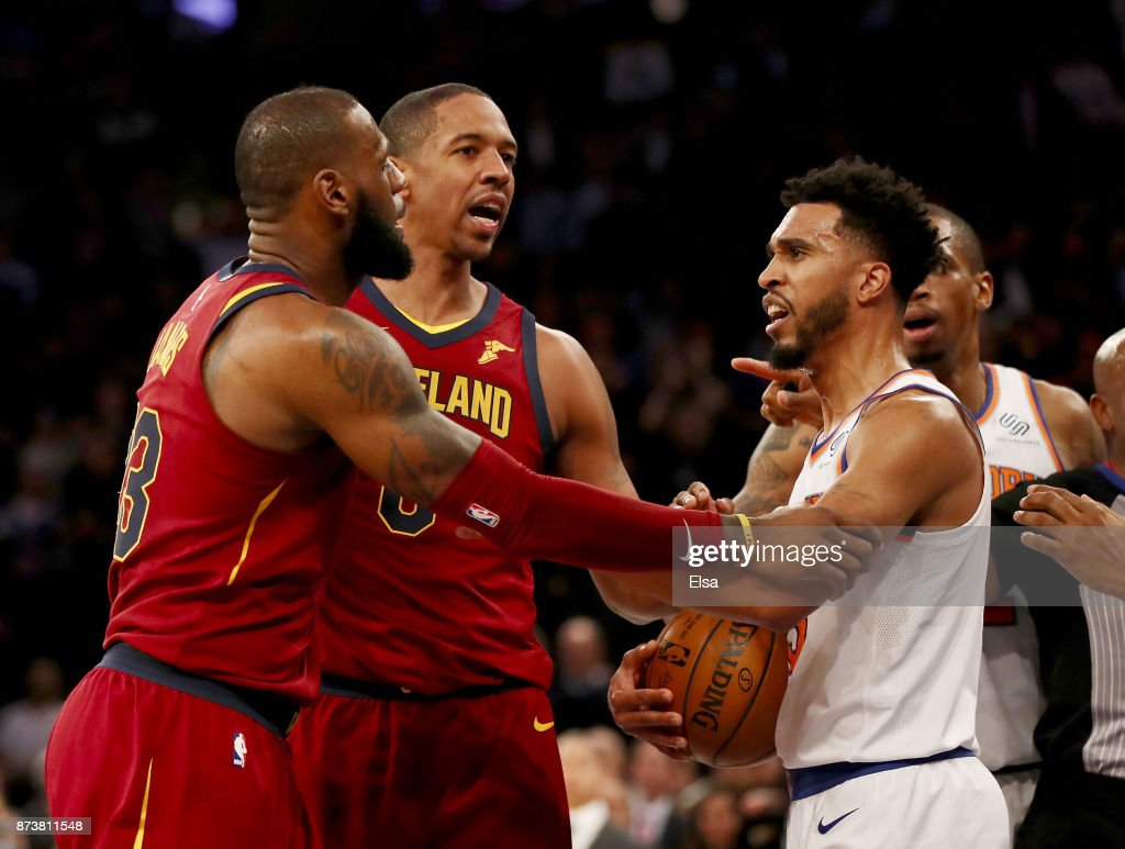 LeBron James #23 of the Cleveland Cavaliers and Enes Kanter #00 of the New York Knicks exchange words as teammates Channing Frye #8 of the Cavaliers and Courtney Lee #5 of the New York Knicks try and separate them at Madison Square Garden on November 13, 2017 in New York City.