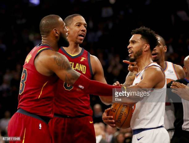 LeBron James of the Cleveland Cavaliers and Enes Kanter of the New York Knicks exchange words as teammates Channing Frye of the Cavaliers and...