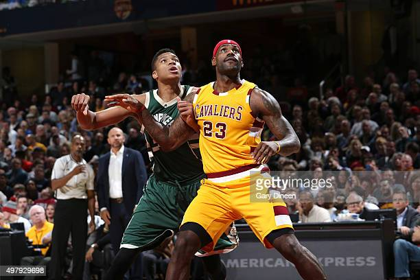 LeBron James of the Cleveland Cavaliers and Giannis Antetokounmpo of the Milwaukee Bucks fight for the position during the game on November 19 2015...