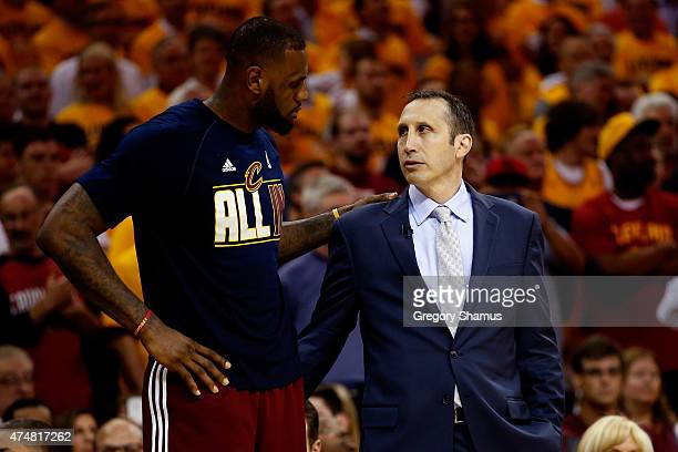 LeBron James of the Cleveland Cavaliers and head coach David Blatt speak late in the fourth quarter against the Atlanta Hawks during Game Four of the...