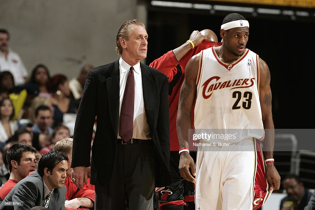 LeBron James #23 of the Cleveland Cavaliers and head coach Pat Riley of the Miami Heat look on during the game action on December 17, 2005 at the Quicken Loans Arena in Cleveland, Ohio. The Cavaliers won 115-107.
