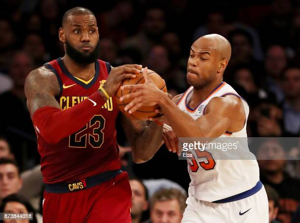 LeBron James of the Cleveland Cavaliers and Jarrett Jack of the New York Knicks fight for the ball in the second half at Madison Square Garden on...