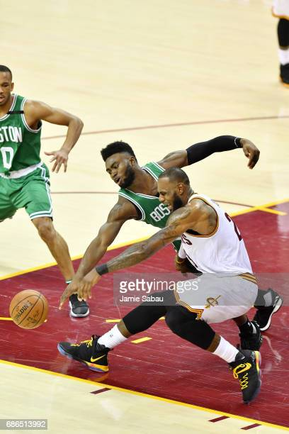 LeBron James of the Cleveland Cavaliers and Jaylen Brown of the Boston Celtics vie for a loose ball in the second quarter during Game Three of the...