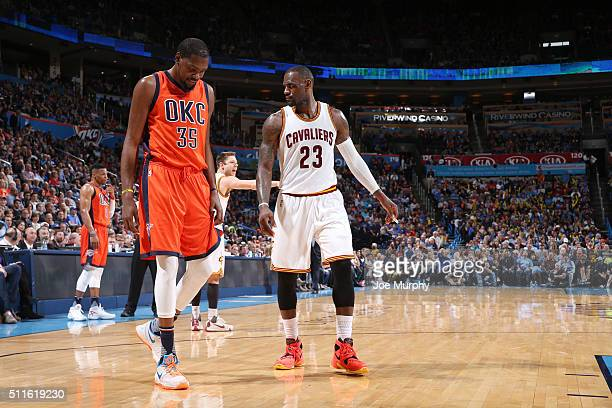 LeBron James of the Cleveland Cavaliers and Kevin Durant of the Oklahoma City Thunder stand on the court on February 21 2016 at Chesapeake Energy...