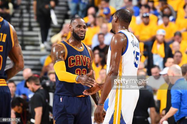 LeBron James of the Cleveland Cavaliers and Kevin Durant of the Golden State Warriors high five each other during Game One of the 2017 NBA Finals at...