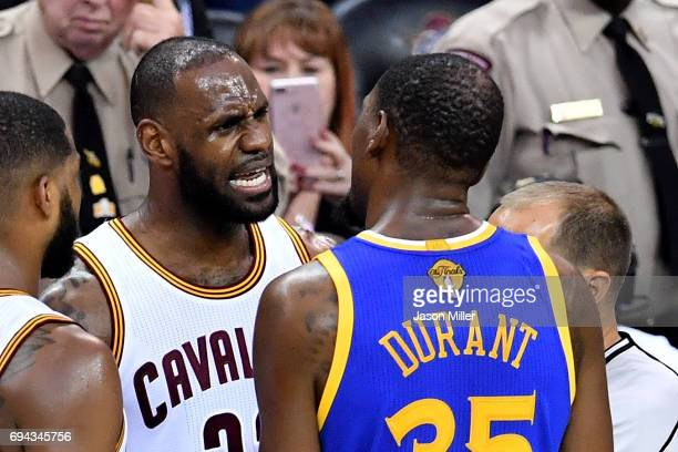 LeBron James of the Cleveland Cavaliers and Kevin Durant of the Golden State Warriors speak after a foul in the third quarter in Game 4 of the 2017...