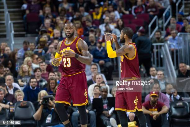 LeBron James of the Cleveland Cavaliers and Kyrie Irving talk after a play during the first half against the New York Knicks at Quicken Loans Arena...