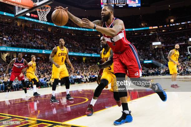 LeBron James of the Cleveland Cavaliers and Markieff Morris of the Washington Wizards fight for a loose ball during the first half at Quicken Loans...