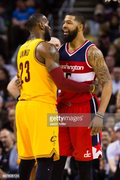 LeBron James of the Cleveland Cavaliers and Markieff Morris of the Washington Wizards talk after a play during the first half at Quicken Loans Arena...