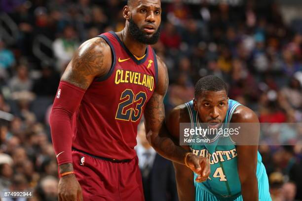 LeBron James of the Cleveland Cavaliers and Michael KiddGilchrist of the Charlotte Hornets on November 15 2017 at Spectrum Center in Charlotte North...