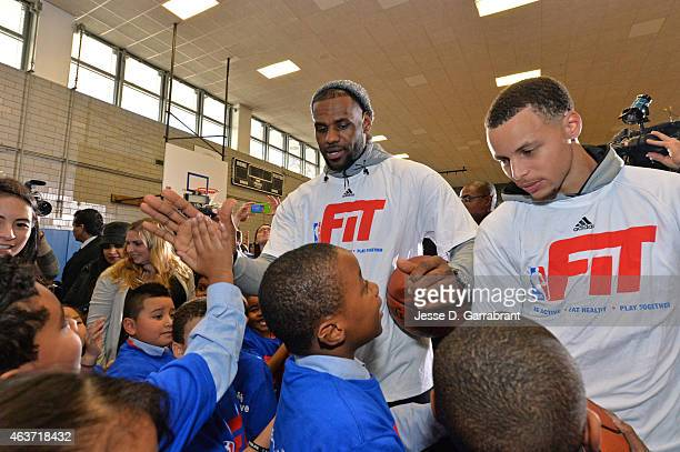 LeBron James of the Cleveland Cavaliers and Stephen Curry of the Golden State Warriors participate in NBA Cares/FIT Day of Service at 439 WEST 49th...