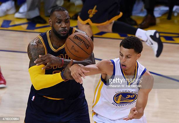 LeBron James of the Cleveland Cavaliers and Stephen Curry of the Golden State Warriors vie for posession during Game One of the 2015 NBA Finals at...