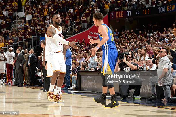 LeBron James of the Cleveland Cavaliers and Stephen Curry of the Golden State Warriors shake hands during Game Six of the 2015 NBA Finals at The...