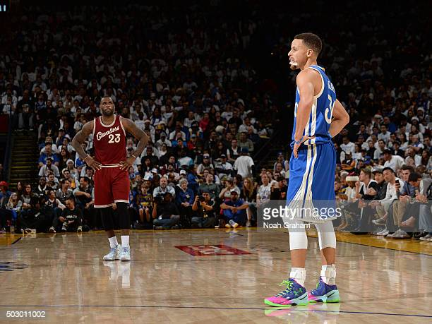 LeBron James of the Cleveland Cavaliers and Stephen Curry of the Golden State Warriors stand on the court together on December 25 2015 at ORACLE...