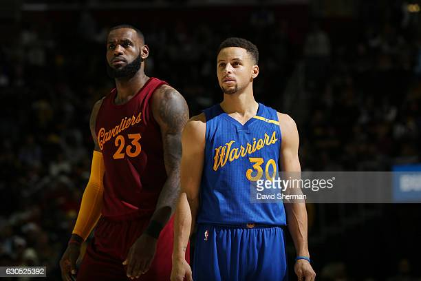 LeBron James of the Cleveland Cavaliers and Stephen Curry of the Golden State Warriors react to a play during the game on December 25 2016 at Quicken...