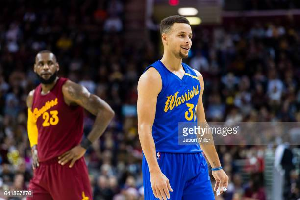 LeBron James of the Cleveland Cavaliers and Stephen Curry of the Golden State Warriors pause on the court during the first half at Quicken Loans...