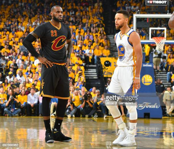 LeBron James of the Cleveland Cavaliers and Stephen Curry of the Golden State Warriors looks on during the game during Game Two of the 2017 NBA...