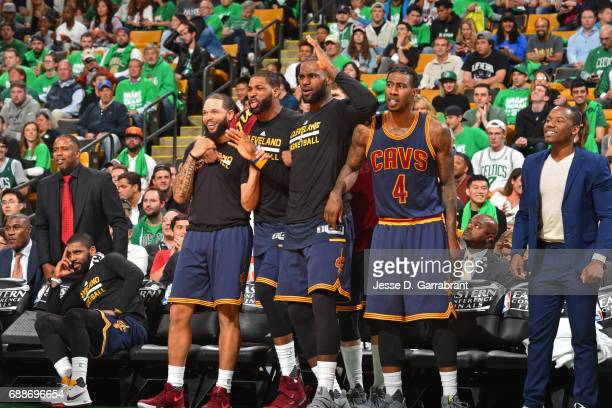 LeBron James of the Cleveland Cavaliers and the bench react to a play in Game Five of the Eastern Conference Finals against the Boston Celtics during...