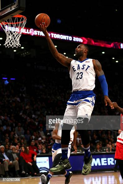 LeBron James of the Cleveland Cavaliers and the Eastern Conference drives to the basket in the first half against the Western Conference during the...